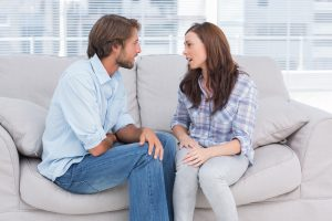 Young couple quarrelling in the office of therapist